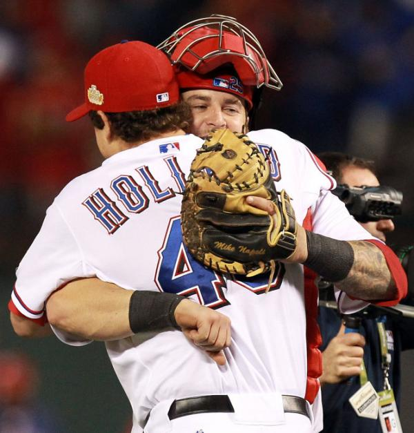 <p>Texas Rangers pitcher Derek Holland and catcher Mike Napoli celebrate after defeating the St. Louis Cardinals 4-0 in game four of the MLB World Series.</p>