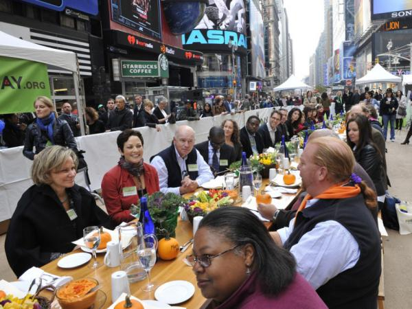 "<p>Participants, including Mario Batali, right, at the ""Eat In,"" a Food Day lunch event in Times Square in New York on Monday. </p>"