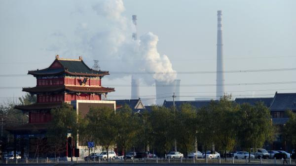 <p>To feed China's insatiable demand for coal, U.S. companies are trying to sell and ship the lucrative commodity to the Asian market from new West Coast ports. Above, the cooling towers of a coal-fired power plant are seen on the outskirts of Beijing.</p>