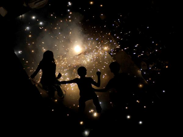 <p>Indian children light fireworks in New Delhi for Diwali, the Hindu festival of lights. The festival marks the victory of good over evil and commemorates the time when Hindu God Lord Rama achieved victory over Ravana and returned to his kingdom Ayodhya after 14 years in exile.</p>