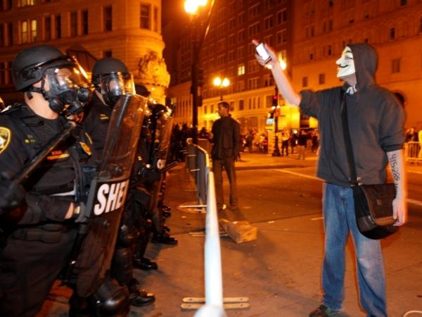 <p>Tuesday in Oakland: An Occupy protester and police.</p>