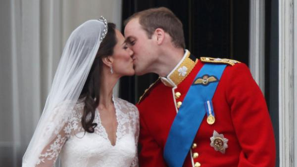 <p>April 29, 2011: Their Royal Highnesses Prince William, Duke of Cambridge and Catherine, Duchess of Cambridge kiss on the balcony at Buckingham Palace after their wedding.</p>