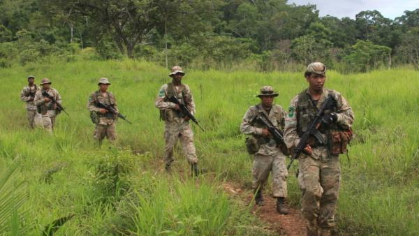 <p>Special forces troops in Belize march through jungle looking for any sign of marijuana or drug smugglers. Drug traffickers have become increasingly active in Belize and other small nations in Central America. </p>
