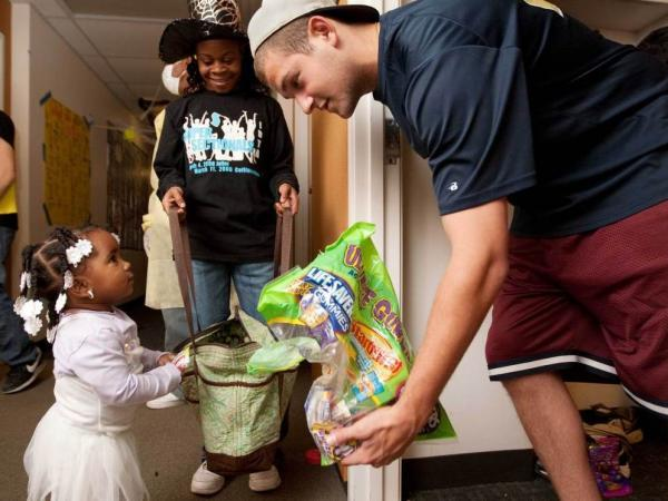 "<p>At Washington University in St. Louis on Sunday, student Andrew Dwoskin was handing out candy to local children during a ""Safe Trick-or-Treat"" event.</p>"