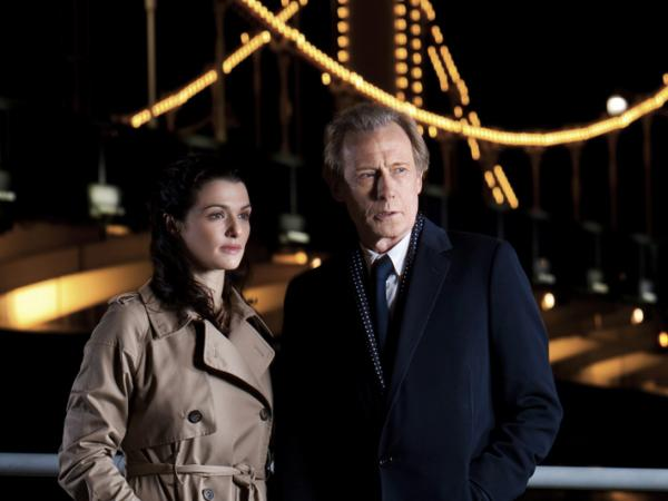 <p>In <em>Page Eight</em>, Bill Nighy plays Johnny Worricker, a spy trying to help his neighbor Nancy Pierpan (Rachel Weisz) discover how her brother died. </p>