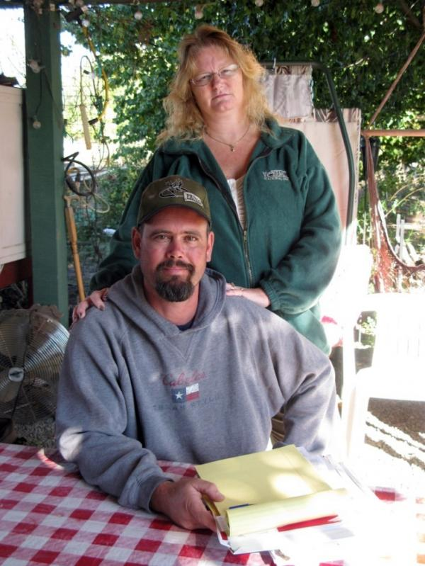 <p>Craig and Linda Black sit at a table in the yard of their home in Vacaville, Calif. They are desperately trying to hang on to their home after falling behind on their mortgage payments.</p>