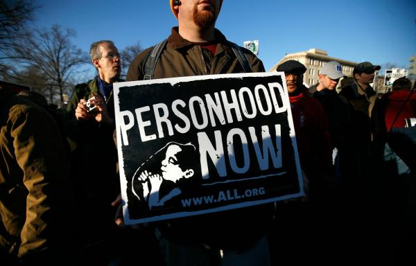 <p>An anti-abortion activist holds a sign at the annual March for Life event in Washington, D.C. Mississippi's statehood amendment would ban abortion with no exceptions for rape or incest.</p>
