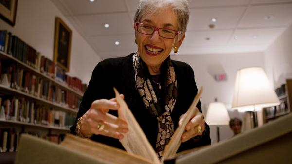 Dava Sobel, who has written a new book about Copernicus, pages through a first edition copy of the astronomer's 1543 work <em>On the Revolutions of the Heavenly Spheres</em> at Dibner Library of the History of Science and Technology at the Smithsonian National Museum of American History in Washington, D.C.