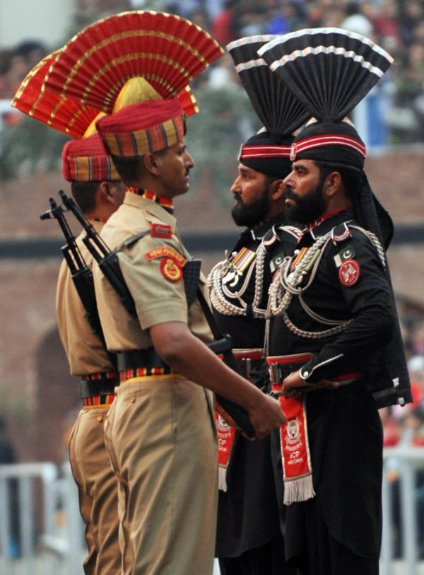 Indian Border Security Force soldiers (in khakhi) and Pakistani Rangers (in black) perform the daily retreat ceremony at the India-Pakistan border in Wagah. It's hoped that freer trade will reduce tensions between their two nations.