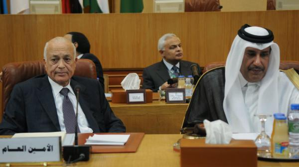 Arab League Secretary General Nabil al-Arabi (L) sits next to Qatari Premier and Foreign Minister Sheikh Hamad bin Jassim bin Jabr al-Thani during a ministerial meeting at the 22-nation organization's Cairo headquarters on the situation in Syria.