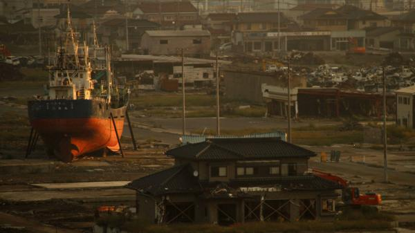 A fishing boat washed ashore by the tsunami that hit Japan March 11 sits in the deserted port area in Kesennuma, Miyagi Prefecture, northeastern Japan, in September. Residents of Kesennuma are now trying to rebuild their town from scratch.