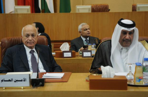 Arab League Secretary General Nabil al-Arabi and Qatari Foreign Minister Hamad bin Jassim listen during a meeting to discuss the situation in Syria, in Cairo on Wednesday.