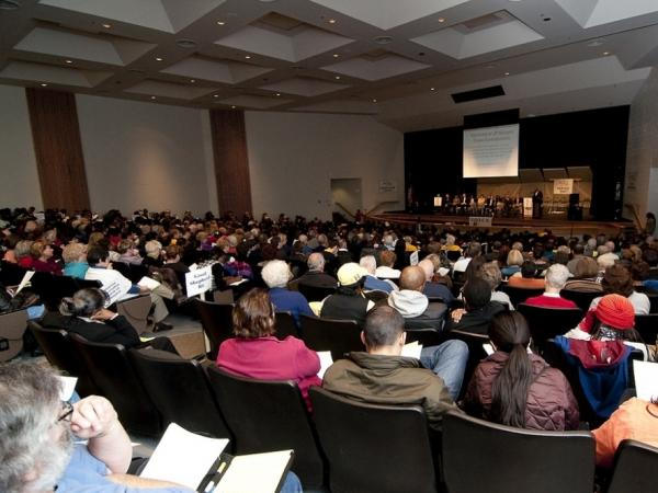 Residents pack an auditorium during a town hall on mortgages organized by Virginians Organized for Interfaith Community Engagement, or VOICE, in Northern Virginia.