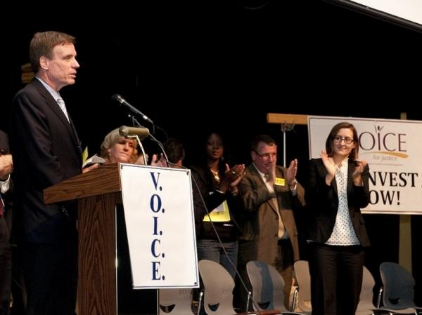 Sen. Mark Warner, D-Va., speaks at a town hall on foreclosure prevention in Woodbridge, Va., on Oct. 30.