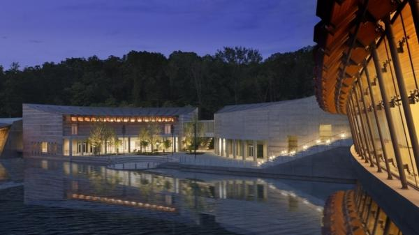 <strong> Of Art And Nature:</strong> A model shows one of the three ponds that will surround Crystal Bridges. The museum got its name from the two galleries that will actually serve as bridges over the ponds. Architect Moshe Safdie says his design is meant to help blend the experience of the museum's art with that of its natural surroundings.