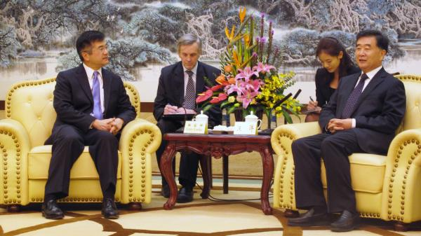 U.S. Ambassador to Beijing Gary Locke (far left) meets Communist Party Secretary for Guangdong province Wang Yang (far right) on Nov. 4. Locke, the first Chinese-American ambassador from the U.S. to Beijing, is earning fans in China with his humble ways — in stark contrast, in some instances, to Chinese officials.