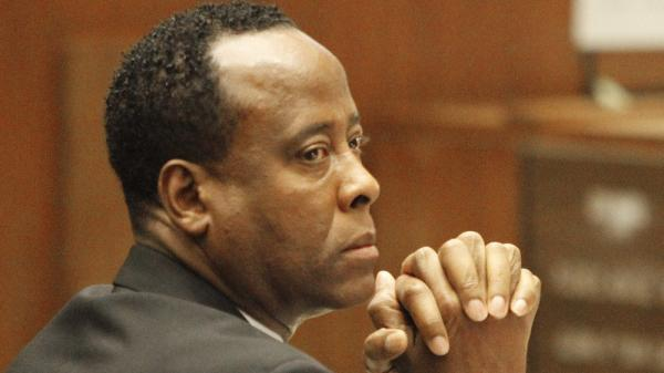 Dr. Conrad Murray watches the testimony of paramedic Richard Senneff, during Murray's involuntary manslaughter trial at the Los Angeles Superior Court on Sept. 30 in Los Angeles.