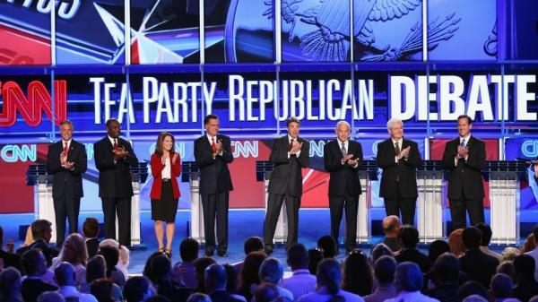 Republican presidential candidates (from left) Jon Huntsman, Herman Cain, Rep. Michele Bachmann, Mitt Romney, Gov. Rick Perry, Rep. Ron Paul, Newt Gingrich and Rick Santorum prepare to debate during the event sponsored by CNN and the Tea Party Express at the Florida state fairgrounds on Sept. 12 in Tampa.
