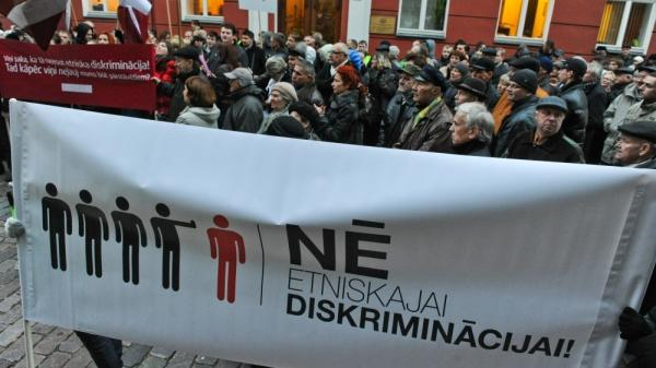 "In September, the pro-Russia Harmony Center party won parliamentary elections in Latvia. But the governing coalition has left the party on the sidelines. Supporters of the Harmony Center party protest in front of the Parliament building during its opening session in Riga on Oct. 17. The banner reads: ""No to ethnic discrimination."""