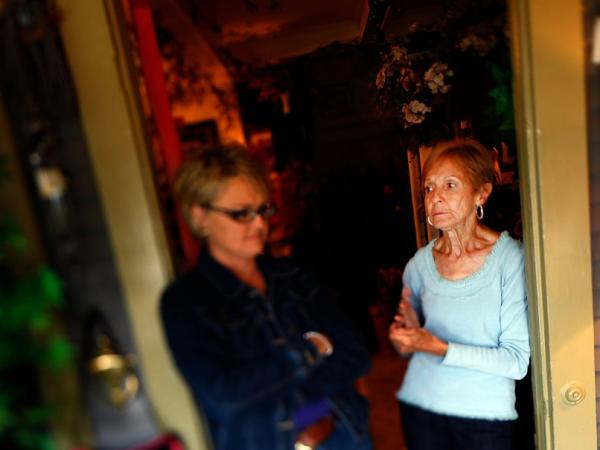Selene Hummer, talks with her mother, Elsie Galemore, at her home-decorating shop in downtown Chanute, Kan.