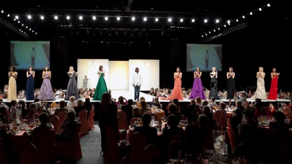 Kevan Hall stands with his models at the Frank Sinatra Fashion Show in February. The designer has dressed A-listers and won multiple awards.