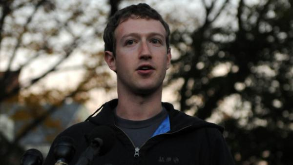 "Facebook is on the verge of adopting new ""opt in"" privacy settings, according to reports. Here, company founder Mark Zuckerberg speaks during a visit to Cambridge, Mass., Monday."