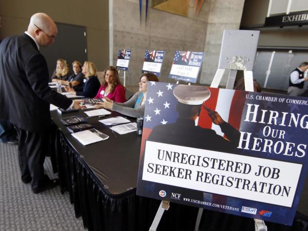 "Veterans register for the ""Hiring Our Heroes"" job fair on Nov. 4 at the South Towne Expo Center in Sandy, Utah. Some 240,000 veterans who served in Iraq and Afghanistan are out of work."