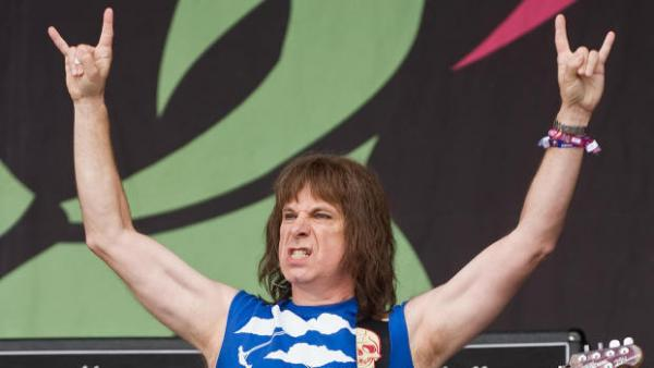 <strong>The Devil's 11's:</strong> Spinal Tap's Nigel Tufnel (a.k.a. Christopher Guest) in concert in 2009. If only he had three arms.