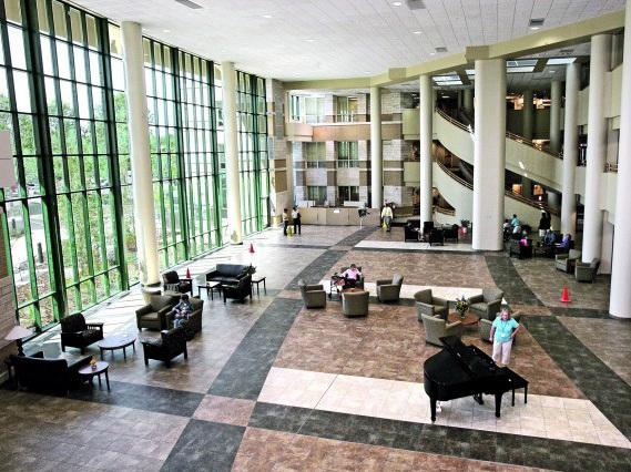 The lobby of the Billings Clinic has an abundance of natural light, and even a piano player, to create a calming, healing ambiance. The center is a top-class health-care facility for cancer treatment.