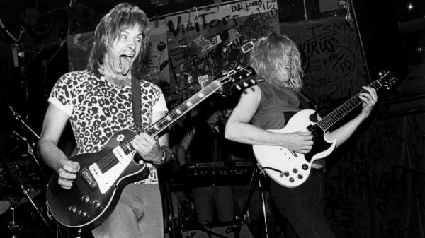 The fictitious band from <em>This Is Spinal Tap</em> performs live at CBGB's in New York in 1984. Nigel Tufnel, the guitarist played by Christopher Guest, favored amplifiers whose volume could be cranked up to 11.