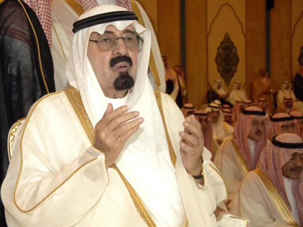 Saudi Arabia's King Abdullah, shown here in 2010, has sent troops to neighboring Bahrain and spent large sums at home in an attempt to limit popular unrest.