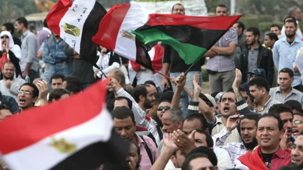 Egyptians attend a rally calling for a rapid transition from military to civilian rule in following the February ouster of president Hosni Mubarak in Cairo's Tahrir Square.