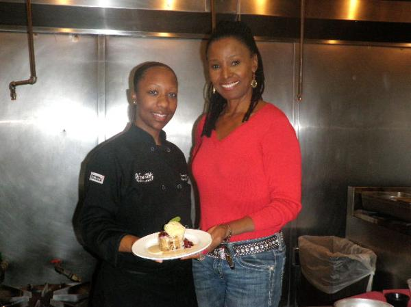 Executive Chef Karida Celestine and restaurateur B. Smith present their Bourbon Street Bread Pudding at Smith's eponymous restaurant in Washington, D.C.