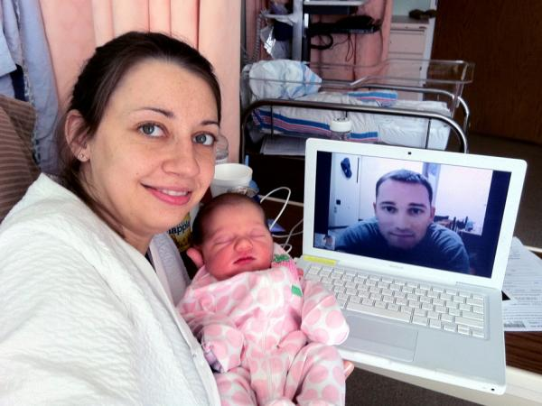 "Lindsey, Natalie and Paul Santana (seen via webcam), the day after Natalie's birth. ""The hospital staff was so incredible to arrange for the Internet connection to make that possible,"" Lindsey says. She calls their Skype chat that day ""such a great memory for us."""