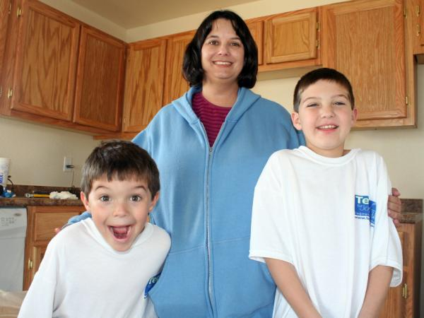 Carrie Cook and her two young sons escaped their Joplin, Mo., apartment just before a tornado obliterated it and most everything inside in May. Now, Cook's small house is one of 10 that Habitat for Humanity is putting up in Joplin this month.