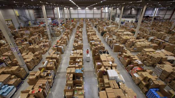 Workers process orders at an Amazon.com fulfillment center n Swansea, Wales, as they prepare for their busiest time of the year.