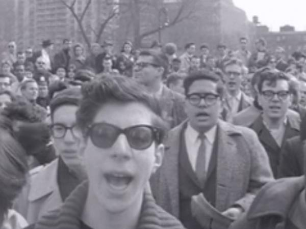 "Protesting crowds at Washington Square  Park sang ""The Star-Spangled Banner"" in an attempt to calm police during the Beatnik Riot."