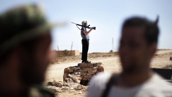 Libyan rebels gather at the front line on the eastern ridge of the Nafusah Mountains in Western Libya on Sunday.