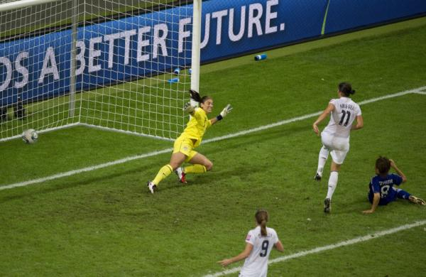Japan's Aya Miyama scores her country's first goal of the Women's World Cup title match, getting the ball past U.S. goalkeeper Hope Solo. Japan won 3-1 in a penalty shoot-out after overtime expired with the two teams tied, 2-2. Japan became the first Asian nation to win the World Cup.