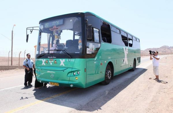 Bus 392 sits on the highway running from Beersheva to Eilat, with windows broken following a gun attack near the Israel-Egypt border.