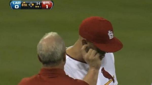 Ouch. Matt Holliday of the St. Louis Cardinals as he left the field Monday night with a moth stuck in his right ear.