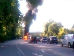 A screen shot of the burning car.