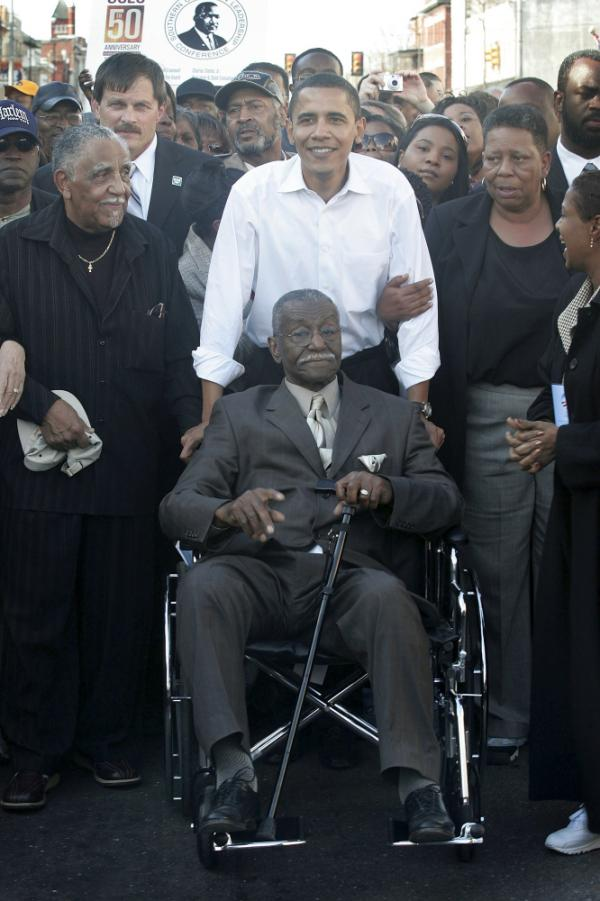 "<p>In this file photo from 2007, Sen. Barack Obama pushes civil rights activist Rev. Fred Shuttlesworth during a commemoration of the 1965 ""Bloody Sunday"" Voting Rights march in Selma, Ala. Shuttlesworth died Wednesday, at age 89.</p>"