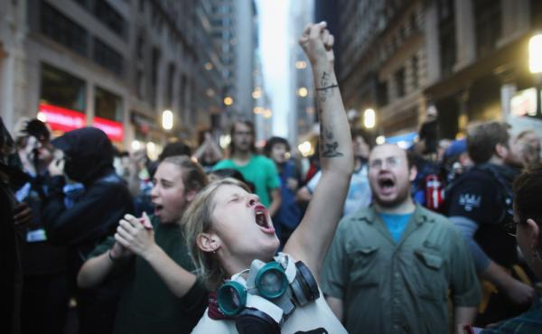 <p>Demonstrators associated with the Occupy Wall Street movement face off with police Friday in the streets of New York City's financial district.</p>