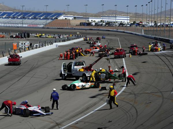 <p>Cars are scattered on the track after the 15-car crash during at the Las Vegas Motor Speedway.</p>