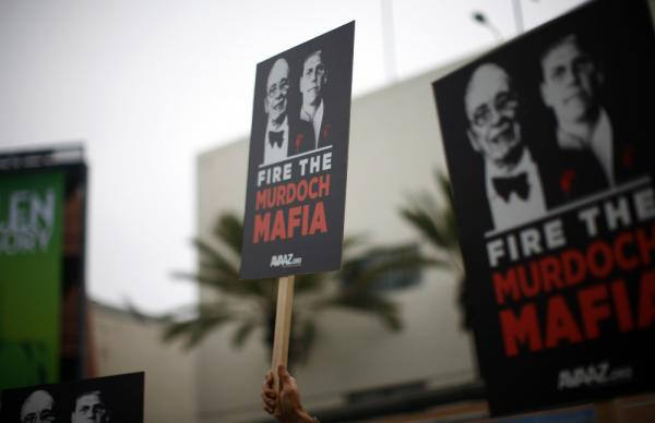 <p>Protesters demonstrate outside the News Corp. annual shareholder meeting at Fox Studios in Los Angeles on Friday. </p>