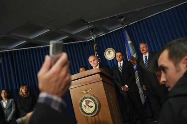 <p>U.S. Attorney for the Southern District of New York Preet Bharara speaks as New York City Police Commissioner Raymond Kelly and Charles Campisi, head of internal affairs, listen during a news conference Tuesday to announce the arrest of five New York Police Department officers on charges that they smuggled firearms, cigarettes and slot machines they believed were stolen.</p>