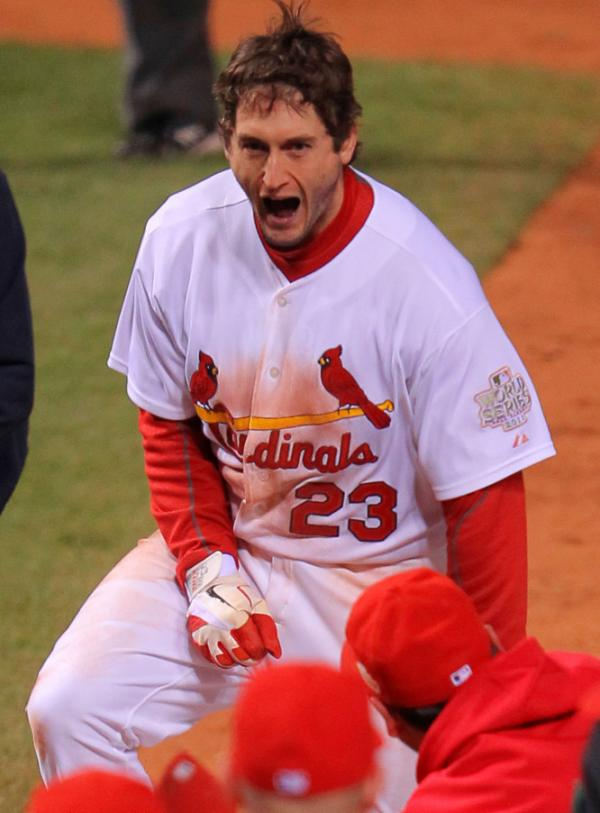 <p>David Freese of the St. Louis Cardinals celebrates at home plate after hitting a walk-off solo home run in the 11th inning to win Game Six of the MLB World Series against the Texas Rangers in St Louis.</p>