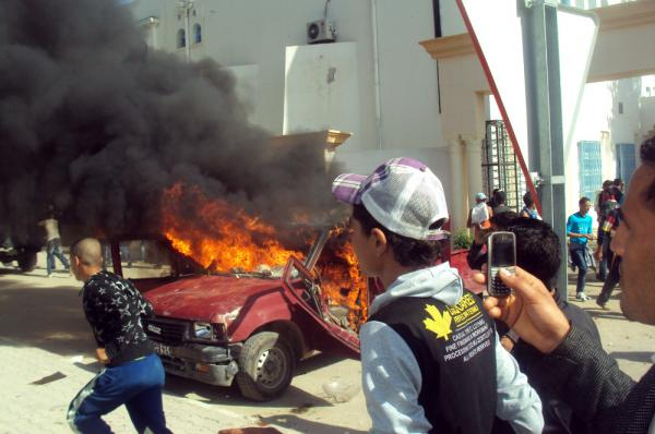 <p>A car burns during clashes between demonstrators and secuitry forces on Friday in Sidi Bouzid. </p>