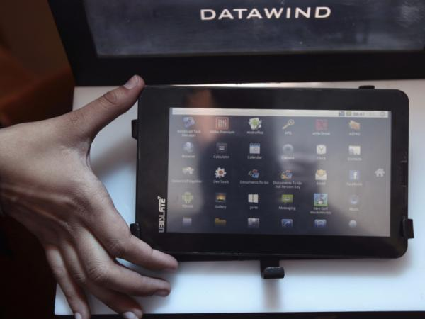 The Aakash tablet computer (shown here during its Oct. 5 launch in New Delhi) can be used for functions like word processing, Web browsing and video conferencing. It has a battery life of about three hours.